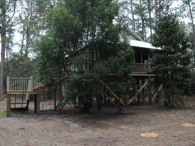 Nestled in the trees, just like a Wood Stork nest is the Wood Stork Cottage.