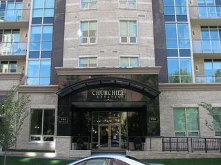 Calgary condo photo - nice front entrance, highly secure building, personal concierge