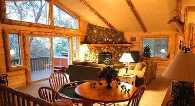 Relax In the large family room with lots of windows yet warm and cozy.