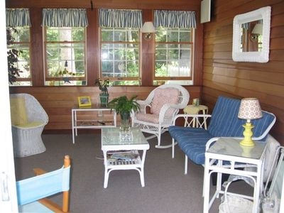 Enclosed sun porch on waterfront side of house