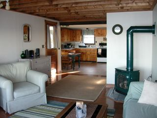 Freeport cottage photo - LIving room has a propane stove to take the cil off on a cooler day.