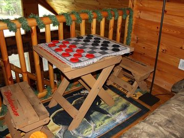 game table with checkers in loft area