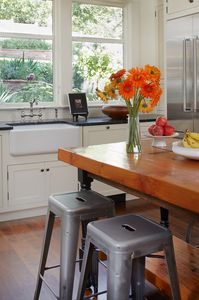Kitchen with view to garden.  Thermador french door refrigerator and farm sink