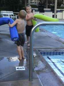 grandsons playing in pool