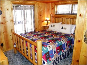 Queen Bed in Bedroom One of the Front Cabin