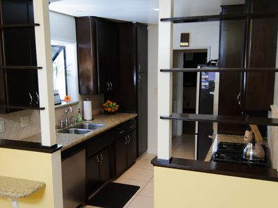 The kitchen features granite counter tops and stainless steel appliances.