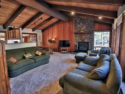 Spacious great room with wood burning fireplace and comfortable furniture