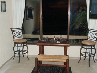 Cancun condo photo - Dining area with Plasma TV - faces west