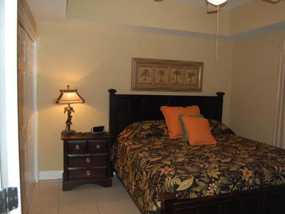 Master with king size bed. Armoire with tv. Tray ceiling with ceiling fan