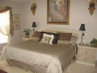 Elegant master bedroom with vaulted ceiling!