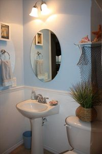 Downstairs Bath - Immerse yourself in a seaside bungalow beach themed room.