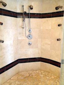 Master bath shower. The 7 spray heads surround you