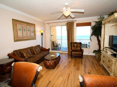 Living room with queen size sleeper sofa, flat screen tv and ocean view