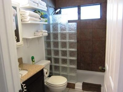 Our newly renovated bathroom! Windows offer great ventilation -but still private