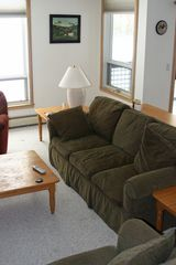 West Dover condo photo - Living room with view of ski home trail.