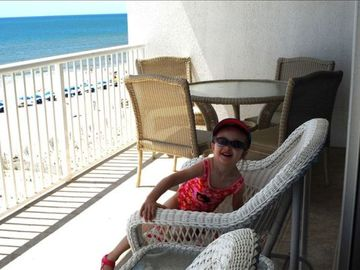 Somebody enjoying balcony waiting on Grandma to get on the beach