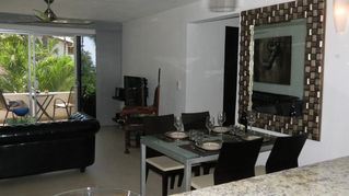 Puerto Vallarta apartment photo - Dining table and sitting area, TV, stereo, DVD, WI-FI internet