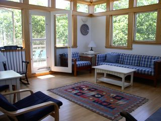 Chilmark house photo - The upper level Living Room w/ the railed deck and deck chairs