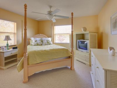 Relax in our 4-poster bed in master bedroom at Poco Place