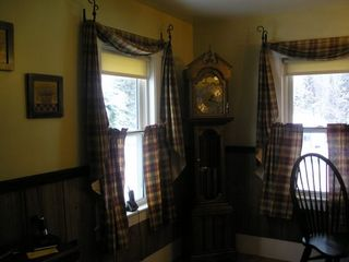 Pittsburg house photo - Grandfather clock looks over the dining room