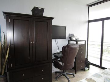 Master bedroom with desk and internet