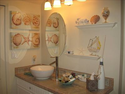 You'll enjoy the contemporary, aquatically decorated bathroom.