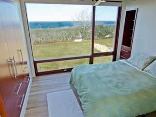 Chilmark house photo - Bedroom #4 - Queen Bed. Sliding Barn Door, Floor-To-Ceiling Windows, Water Views, Mahogany Built-ins
