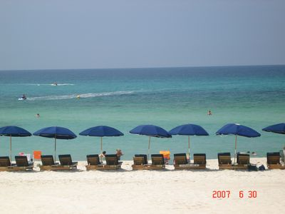 we offer free beach chair service-two cushioned lounge chairs with an umbrella