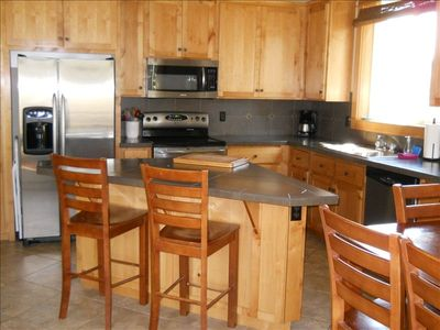 Fully equipped kitchen with stainless appliances.