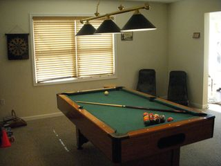 Gameroom has a full size pool table, darts, and 2 gaming chairs! - Towamensing Trails chalet vacation rental photo