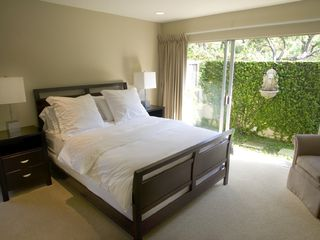 Hollywood estate photo - Large guest bedroom w/ outside courtyard