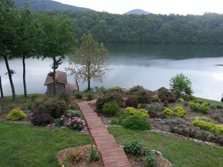 Huddleston cabin photo - The beautiful gardens welcome you on your walk to the waterfront
