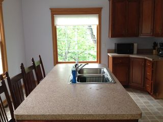 Utica house photo - Bar / island in kitchen provides area to eat breakfast or prepare meals