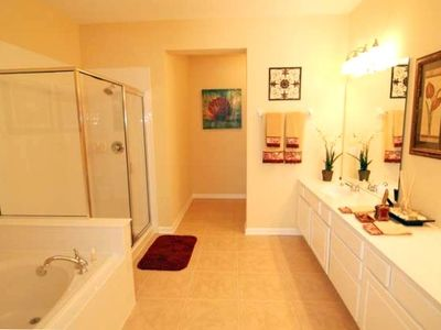 Beautiful master bath with soaking tub, shower, and double sinks
