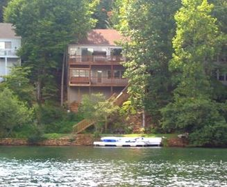 Lake Arrowhead cabin rental - View of lake house from our pontoon. Deep water, no wake, great views, two decks