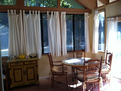 Sunroom: beautiful dining area adjacent to outdoor jacuzzi.