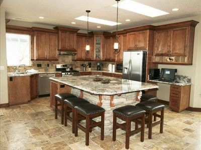 Fully Equipped Gourmet Kitchen with a Large Granite Island Bar