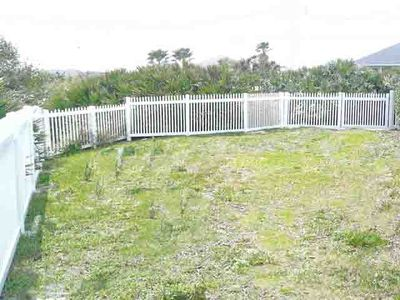 Fenced yard on south side of house; 3 lockable gates; your dog will love it!