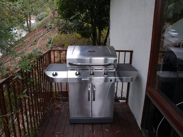 Gas grill on deck.