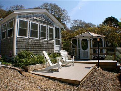 Front of cottage, with gazebo and deck.