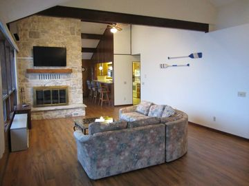 "Great room with 47"" TV over the wood burning fireplace"