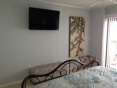 Master bedroom mounted 42 inch TV with netflix