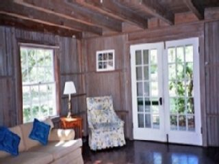 Living Room French Doors Lead to Screened Porch