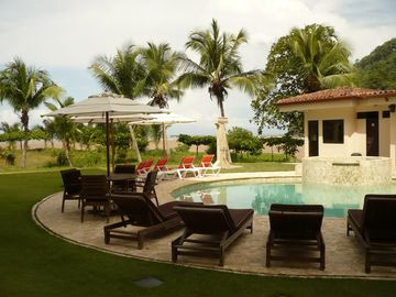 The swimming pool gardens gently blend with a sandy stretch of secluded beach.