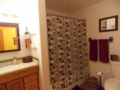 Santa Fe bungalow rental - Gear up for a night on the town or wind down with a relaxing soak in the tub.