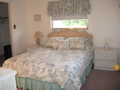 Queen Bed with large walk-in closet.