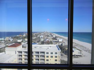 Pensacola Beach condo photo - Striking view of island from dining area, Santa Rosa Sound (L), Gulf (R)