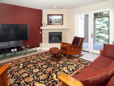"Family Room with 60"" HDTV and door to deck & open space"