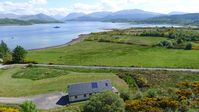 Large Farmhouse and Lodge with hot tub on shore of Scottish Loch