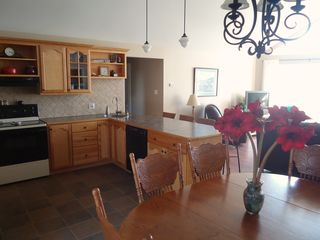 Miminegash cottage photo - Well equipped, bright kitchen with a view of the ocean and sunsets.